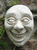 grinner face sculpture walldecor
