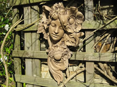 Classical garden wall sculpture