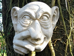 Unusual Garden sculpture of garden troll picking nose